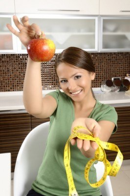 Lovely-Lady-Holding-Measuring-Tape-Apple