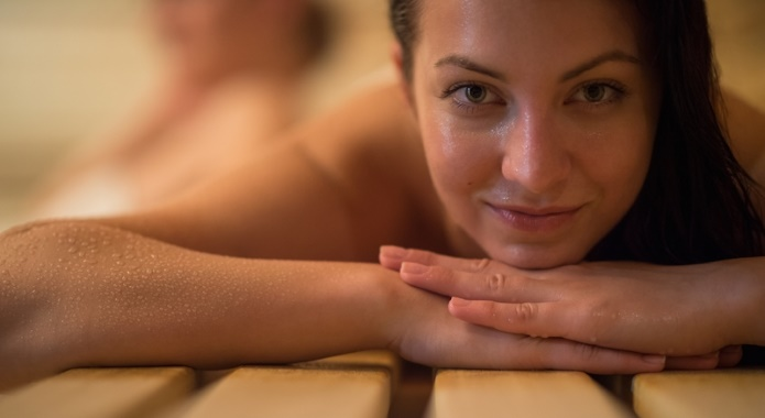 woman sweating in sauna